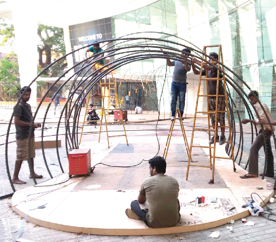 Workers setting up the deco for the International Film Festival of India 2018 in the INOX courtyard in Panaji on Friday.