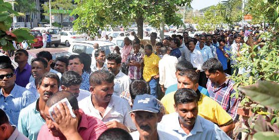 Mining dependents throng the streets of Panaji to drum up support for their demand of early resumption of mining.