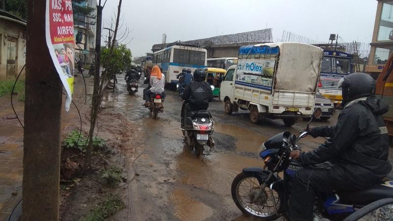Potholed road near Belagavi   Railway gate irks tourists